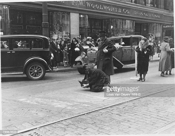 Margaret BourkeWhite taking photographs of downtown Cleveland assisted by Louis Van Oeyen BourkeWhite briefly attended Western Reserve University and...
