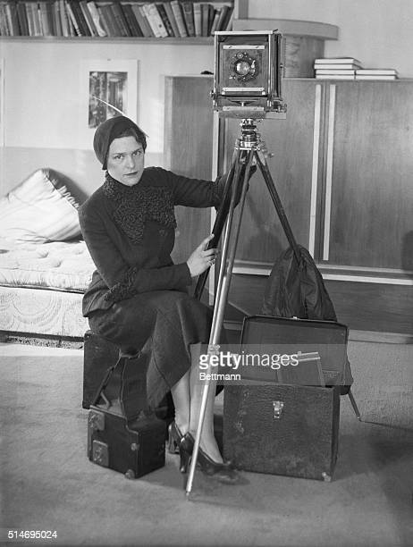 Margaret BourkeWhite with the camera which accompanied her on her tour of Russia for the purpose of studying the 5year plan and making pictorial...