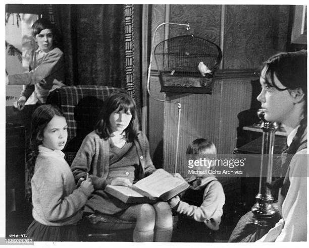 Margaret Brooks seated with a bible in her lap tells her brothers and sisters John Gugolka Louis Sheldon Williams Gustav Henry Mark Lester and Phoebe...