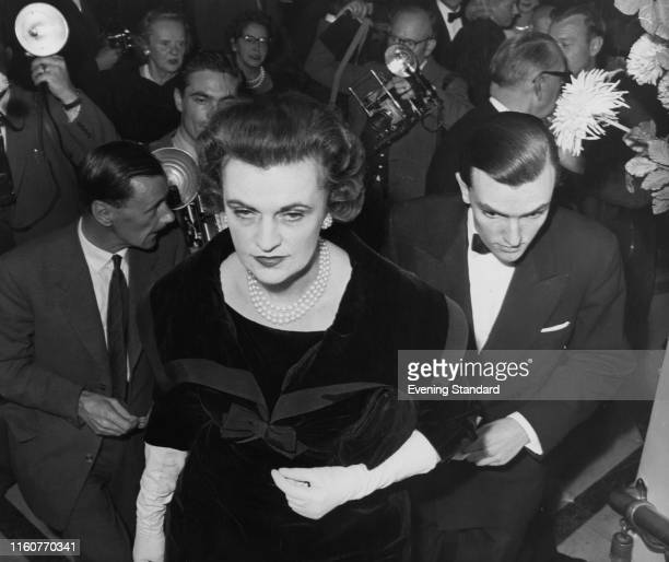 Margaret Campbell, Duchess of Argyll arrives at the Westminster Theatre with her son, Brian Sweeny, London, 10th October 1959. They are attending the...