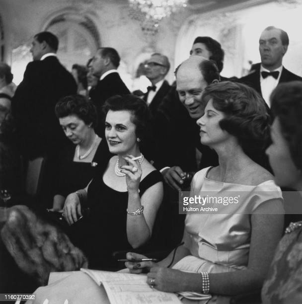 Margaret Campbell, Duchess of Argyll at an event with her friend, Lady Edith Foxwell , 9th October 1959.