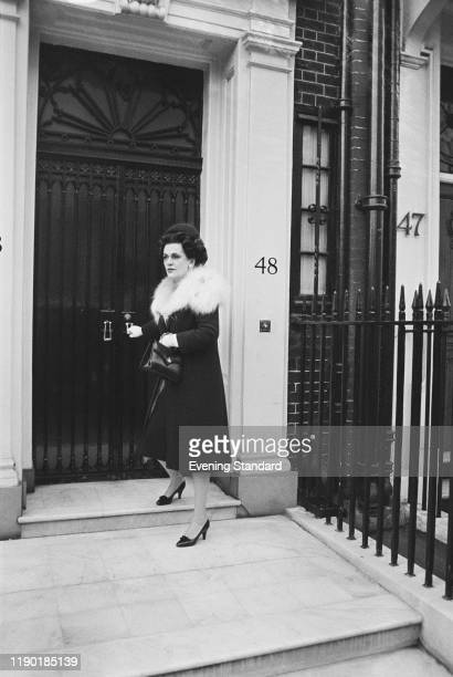 Margaret Campbell, Duchess of Argyll , former third wife of Ian Campbell, 11th Duke of Argyll, closes the front door of her house at 48 Upper...