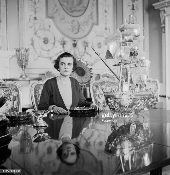 Margaret Campbell Duchess of Argyll pictured seated with a golden galleon table piece at the table in the dining room of Inveraray Castle the seat of...