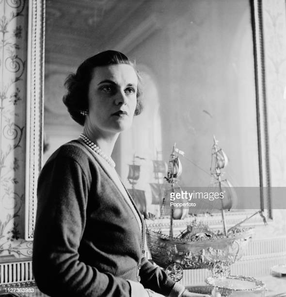 Margaret Campbell Duchess of Argyll pictured with a golden galleon table piece at the dining table in the dining room of Inveraray Castle the seat of...
