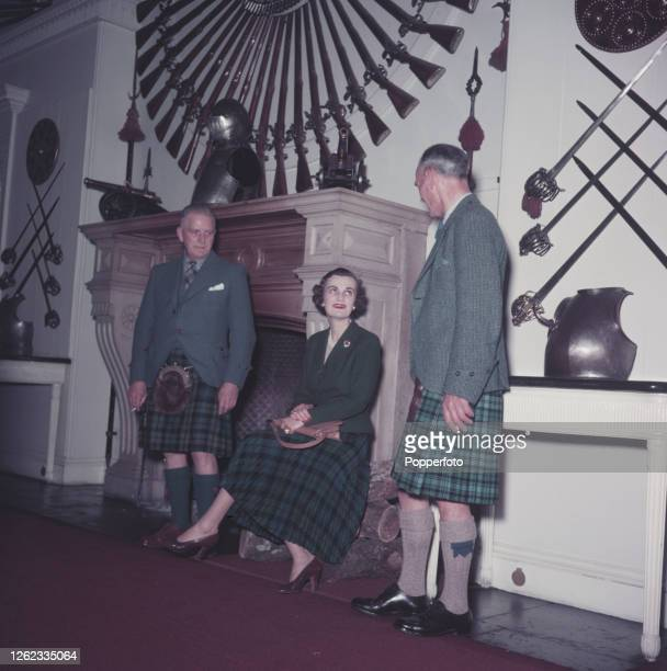 Margaret Campbell, Duchess of Argyll , seated in centre in the Great Hall with two castle guides, James Hamilton Baird and K Miller Smith prior to...