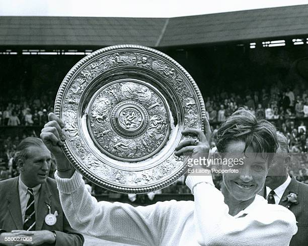 Margaret Court of Australia holding the trophy after winning the Ladies Singles Championship on Centre Court at the All England Lawn Tennis Club in...