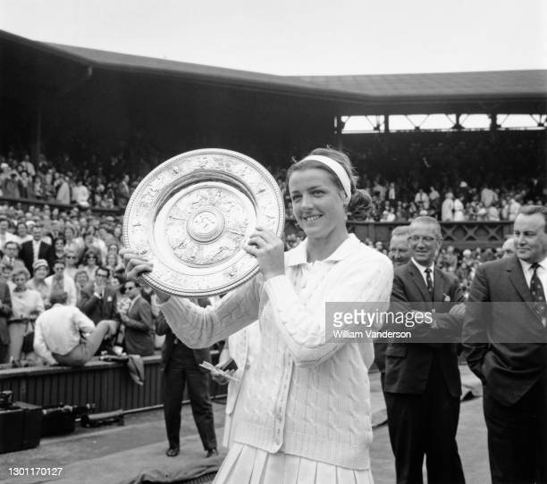 Margaret Court of Australia holds the Venus Rosewater Dish aloft after defeating Billie Jean King of the United States in their Women's Singles Final...