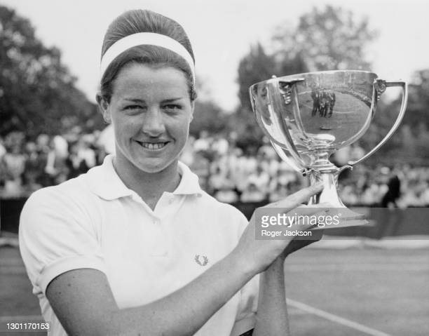 Margaret Court of Australia holds the Women's Singles trophy aloft after defeating compatriot Jan Lehane in their Women's Singles Final match at the...