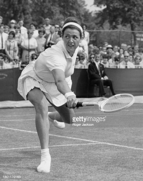 Margaret Court of Australia makes a backhand return to compatriot Jan Lehane during their Women's Singles Final match at the Kent Tennis...
