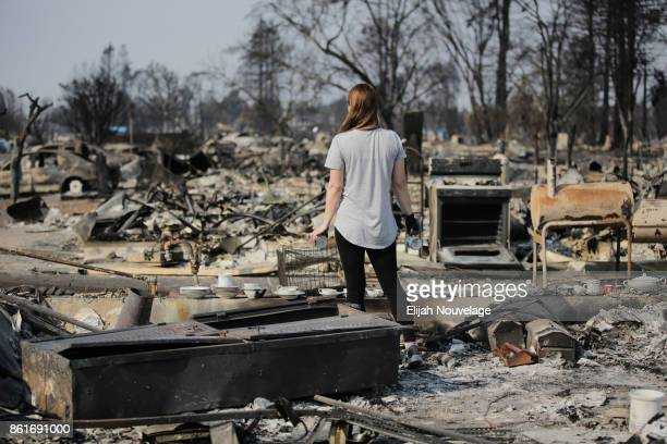 Margaret Curzon looks out at the destruction caused by the Tubbs fire while holding items of emotional importance salvaged from her childhood home in...