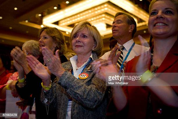 Margaret Davis of North Carolina tears up as US Sen Hillary Clinton speaks at an EMILY's List gala during day two of the Democratic National...