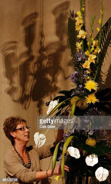 Margaret Delany works on the Floral arrangement which represents St Lucia in preparation for the Commonwealth Observance service in Westminster Abbey...