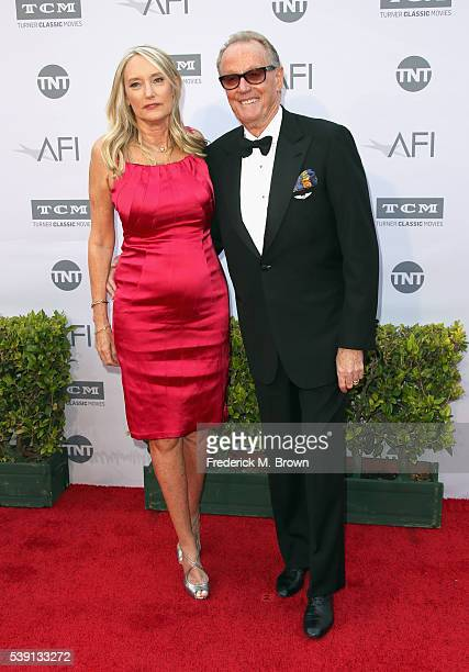 Margaret DeVogelaere and actor Peter Fonda arrives at the American Film Institute's 44th Life Achievement Award Gala Tribute to John Williams at...