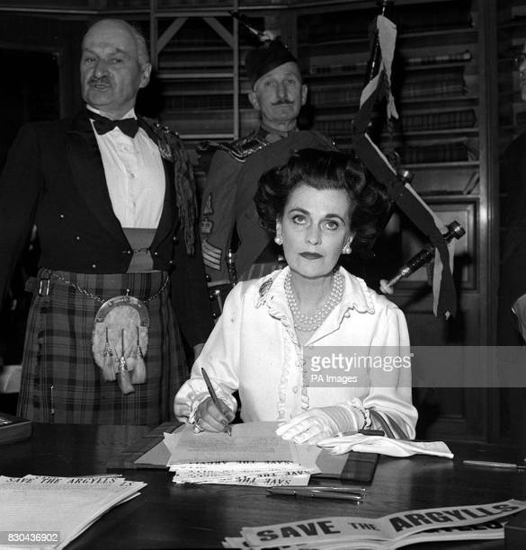 Margaret Duchess of Argyll collectiong signatures at the Scotch House London for a public petition against the decision to disband the Argyll and...