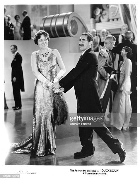 Margaret Dumont dances with Groucho Marx in a scene from the film 'Duck Soup' 1933