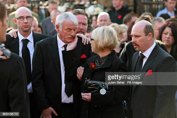 Margaret Gately comforts her husband Martin outside St Laurence O'Toole Church in Dublin where their son Stephen's funeral has been taking place