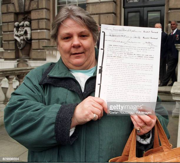 Margaret Godsell holds up a copy of Diana Princess of Wales' will outside Somerset House after the will was published today by lawyers Lawrence...