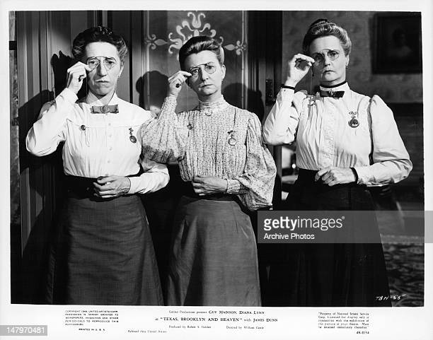 Margaret Hamilton Irene Ryan and Moyna Magill adjust their glasses in a scene from the film 'Texas Brooklyn Heaven' 1948