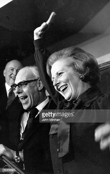 Margaret Hilda Thatcher nee Roberts with her husband Denis waving to the crowds outside the Tory Headquarters