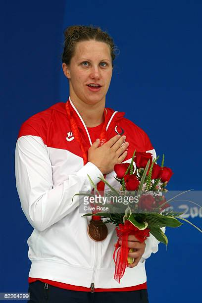 Margaret Hoelzer of the United States poses with the bronze medal during the medal ceremony for the Women's 100m Backstroke held at the National...