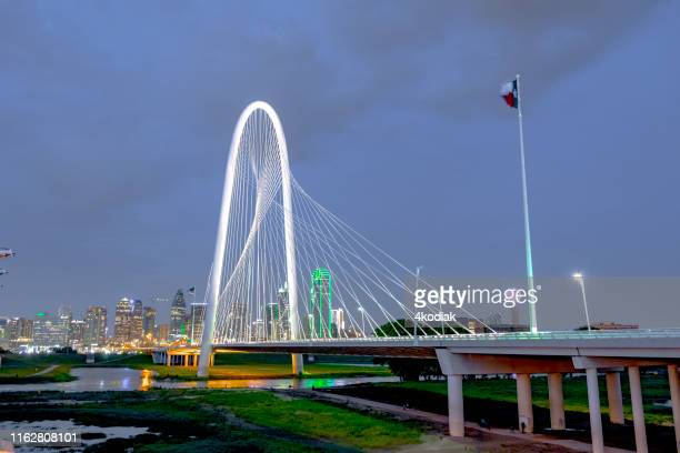 margaret hunt hill bridge with dallas skyline in the background - trinity river texas stock pictures, royalty-free photos & images