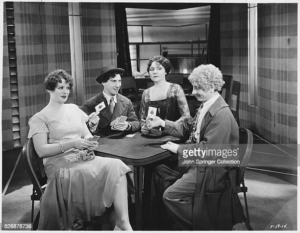 Margaret Irving Chico Marx Margaret Dumont and Harpo Marx play a game of cards in the 1930 Marx Brothers comedy Animal Crackers