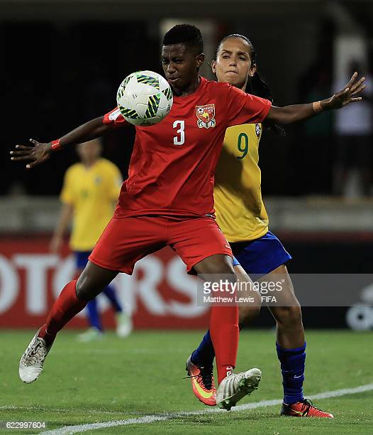 Margaret Joseph of Papua New Guinea and Duda of Brazil challenge for the ball during the FIFA U20 Women's World Cup Papua New Guinea 2016 Group A...