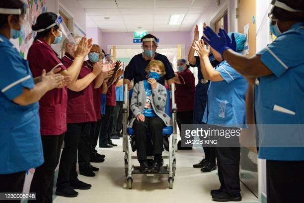 Margaret Keenan is applauded by staff as she returns to her ward after becoming the first person to receive the Pfizer-BioNtech Covid-19 vaccine at...