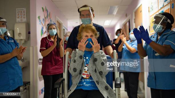 Margaret Keenan is applauded by staff as she returns to her ward after becoming the first person in the United Kingdom to receive the Pfizer/BioNtech...