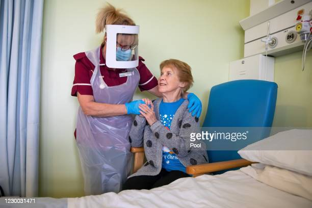 Margaret Keenan the first patient in the United Kingdom to receive the Pfizer/BioNtech covid-19 vaccine, speaks with Healthcare assistant Lorraine...