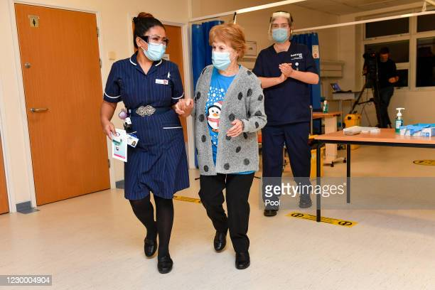 Margaret Keenan walks with nurse May Parsons after becoming the first patient in the United Kingdom to receive the Pfizer/BioNtech covid-19 vaccine...