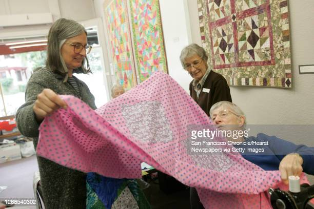 Margaret Knight and Rachel Bradley share ideas on a quilt.After watching the disaster from Hurricane Katrina unfold, members of the East Bay Heritage...