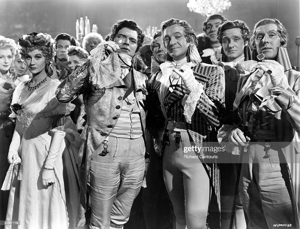 Margaret Leighton (1922 - 1976), Jack Hawkins (1910 - 1973), David Niven (1909 - 1983) and Robert Coote (1909 - 1982) feature in this scene from 'The Elusive Pimpernel', an expensive film version of Baroness Orczy's classic novel. Also titled 'The Fighting Pimpernel', the film was directed by Michael Powell and Emeric Pressburger for London Films.