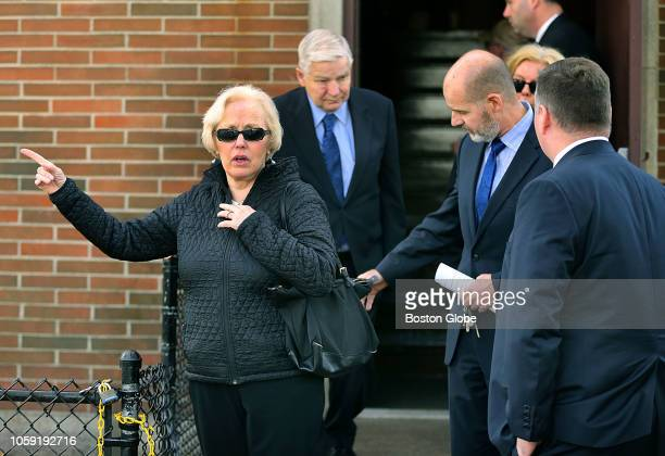 Margaret McCusker, Catherine Greig's sister, and William Bulgar' and his sons leave the funeral service was held for slain gangster James Whitey...