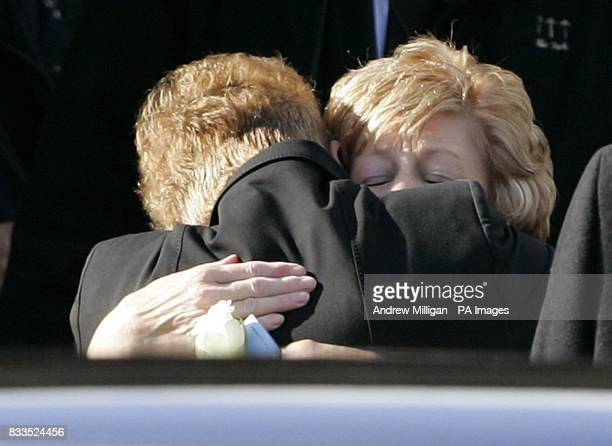Margaret McRae's mother gets a hug as she leaves the funeral of Colin McRae and son Johnny at East Chapel, Daldowie Crematorium.