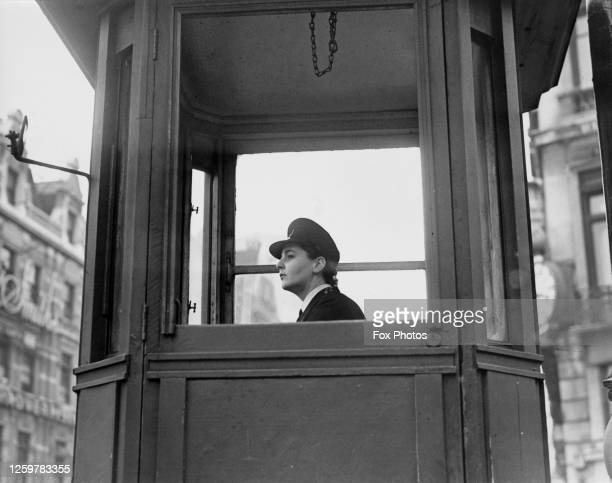 Margaret Moulton directing traffic from the control box at Ludgate Circus in London, England, 28th September 1950. This is the first time the traffic...