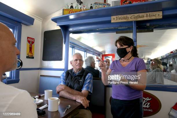 Margaret Murphy, who has worked as a server at Brunswick Diner for 24 years, takes orders from regular customers Jeff Desrosiers, far left, and...