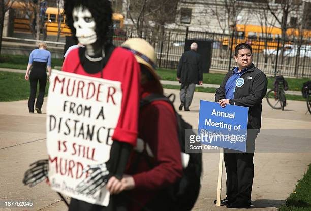 Margaret Nelson holds a puppet as she demonstrates with other protestors outside the Field Museum as shareholders arrive for The Boeing Company's...