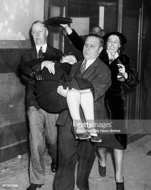 Margaret O'Connor mother of Mary O'Connor who is on trial for the murder of little Nancy Glenn is carried away after fainting as she waited for jury...