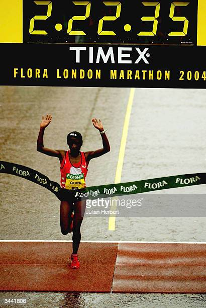 Margaret Okayo of Kenya crosses the line to win the ladies competition at the finish of The Flora London Marathon held on April 18 2004 in London