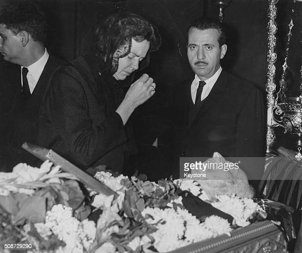 Margaret Papandreou crying as he stands over the open casket of her deceased father former Greek Prime Minister Georgios Papandreou November 6th 1968
