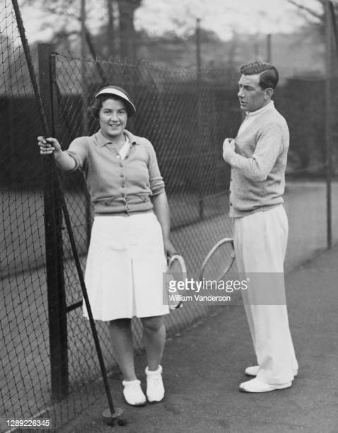 Margaret Peggy Scriven of Great Britain during a practice game under the coaching of Dan Maskell for the forthcoming Wimbledon Lawn Tennis...