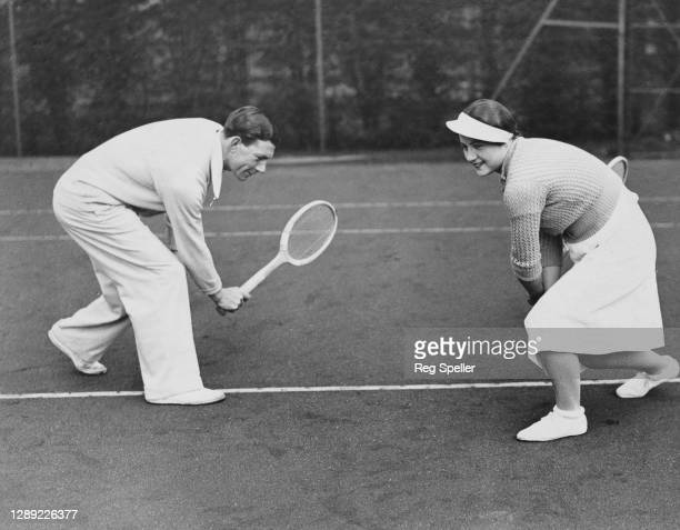 Margaret Peggy Scriven of Great Britain during a practice game under the coaching of Dan Maskell on 19th January 1934 at the All England Lawn Tennis...