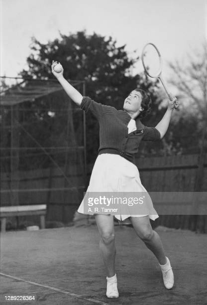 Margaret Peggy Scriven of Great Britain practicing her serve technique during practice on 31st March 1938 at the Westhall Tennis courts in Kew,...