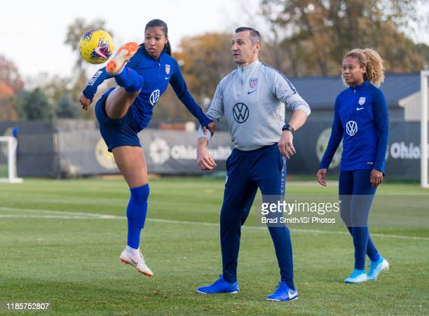 Margaret Purce of the United States clears the ball in front of Vlatko Andonovski at Columbus Crew Training Facility on November 3 2019 in Columbus...