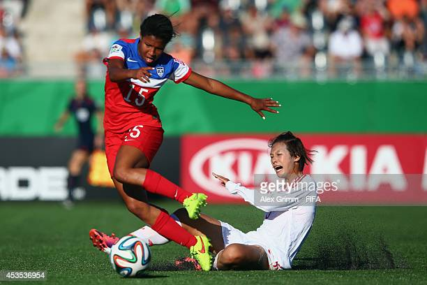 Margaret Purce of the United States is challenged by Lyu Siqi of China PR during the FIFA U20 Women's World Cup Canada 2014 group B match between the...