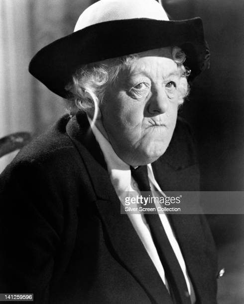 Margaret Rutherford British actress wearing a black hat black coat and a white blouse with a black tie in a publicity still issued for the film...