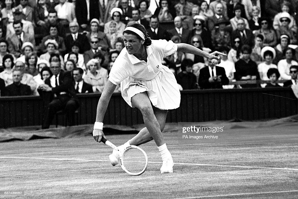Margaret Smith stoops to play a backhand