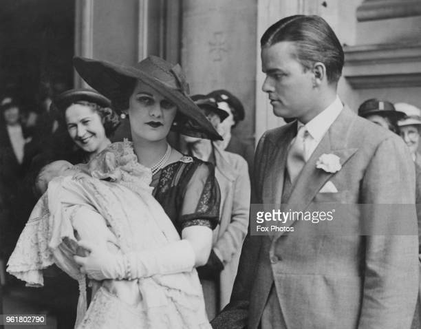 Margaret Sweeny and her husband Charles Sweeny at Brompton Oratory in London for the christening of their daughter Frances Helen 21st July 1937...