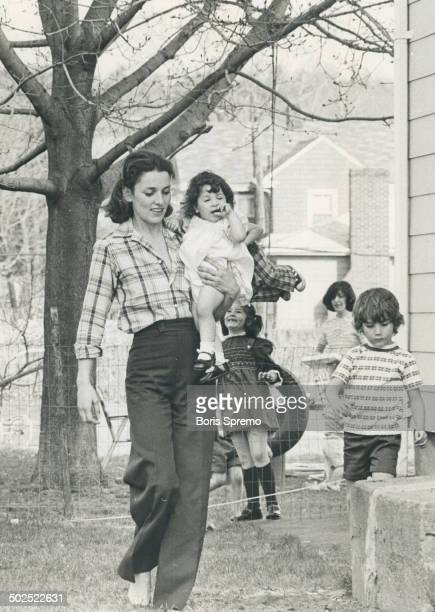 Margaret Trudeau with friends girl in her arm and Justin at right